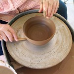 pottery - katie cleaning bowl